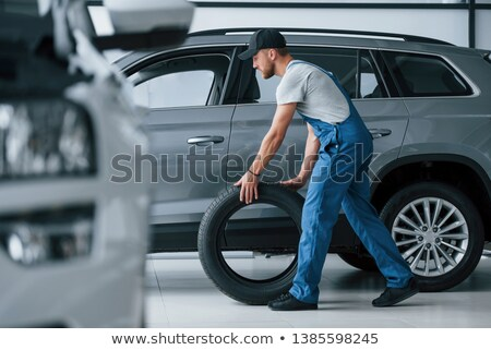 mechanic holding a tire stock photo © photography33