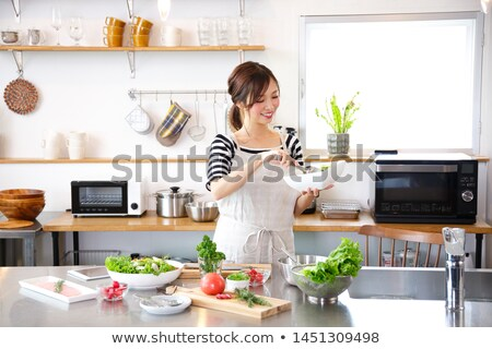 young girl cooking salad Stock photo © photography33