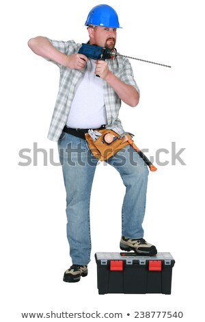 Tradesman holding a drill with a long bit Stock photo © photography33