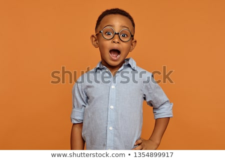 closeup of cheerful african boy with eye wear stock photo © stockyimages