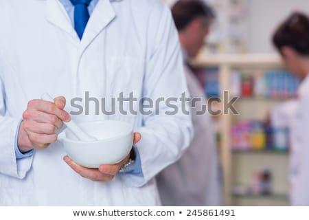 Female Pharmacist with Mortar and Pestle Stock photo © JamiRae