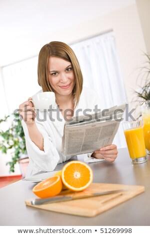 женщину халат чтение газета воды Сток-фото © photography33