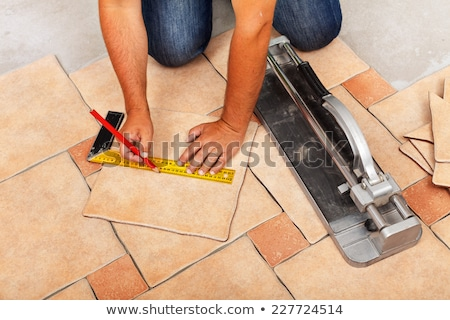Сток-фото: плитка · рабочие · рук · керамической