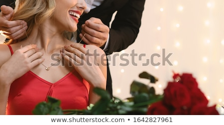 Girls putting on jewellery Stock photo © photography33