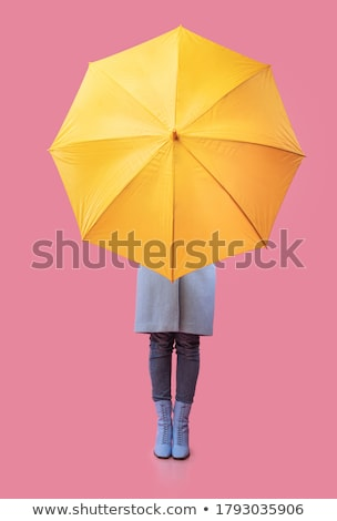 autumn background young woman hiding from rain with umbrella stock photo © involvedchannel
