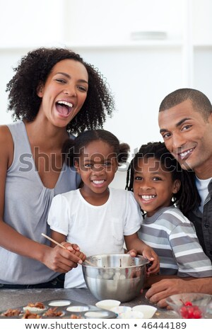 Jolly young family cooking together Stock photo © wavebreak_media