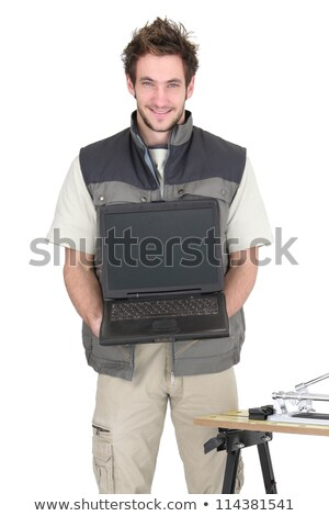 Young tiler holding a laptop with a blank screen Stock photo © photography33