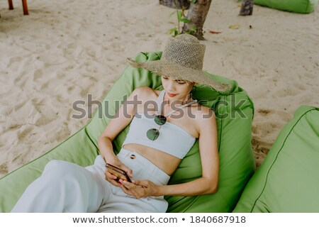 Young bikini woman relaxing on deckchair Stock photo © stockyimages