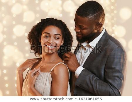 Nő gyémánt nyaklánc gyönyörű nő tart fényes Stock fotó © dolgachov