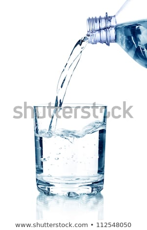 pouring water into the glass isolated on a white background stock photo © inxti