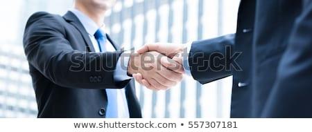 Negocios apretón de manos primer plano blanco fondo empresario Foto stock © stevemc