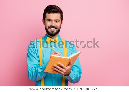 Handsome man in a bow tie writing notes Stock photo © Discovod