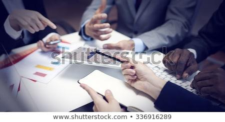 üzleti csapat megbeszél grafikon csoportkép üzleti grafikon fal Stock fotó © Kzenon