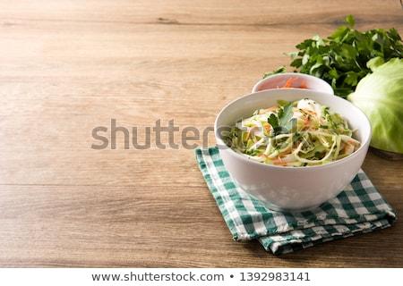 капустный салат чаши деревянный стол продовольствие фон Салат Сток-фото © phila54