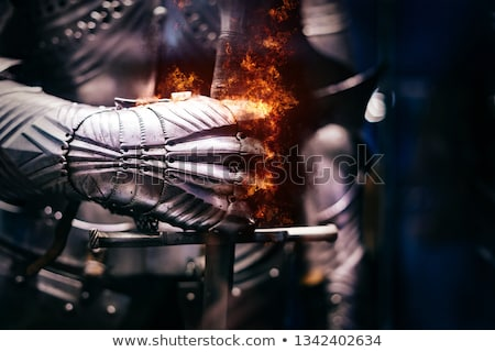 Stock photo: Medieval knight on fire background.