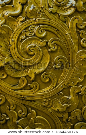 Beautiful golden bas-relief on a old wall Stock photo © Nejron