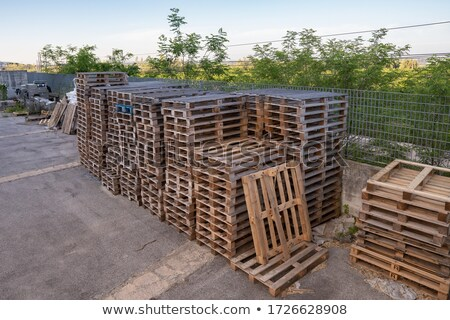 Stacks of old wooden pallets in a yard Stock photo © juniart