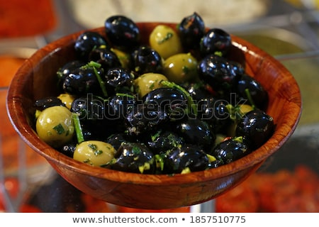 Olives and pickles on display at a farmers market Stock photo © juniart