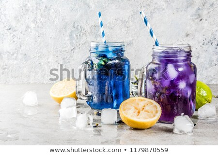 lemon juice and butterfly pea cold drink stock photo © nalinratphi
