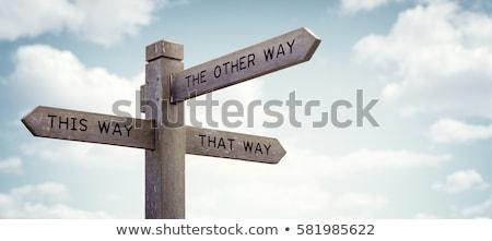 дорожный знак право цвета небе небо Сток-фото © cherezoff