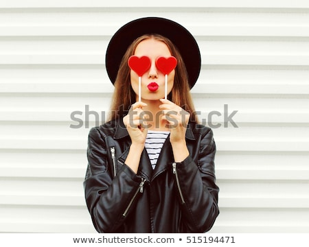 beautiful young woman with red lips wearing summer black hat with large brim stock photo © arturkurjan