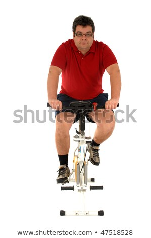 Stock photo: Over weight men working out in a static bicycle