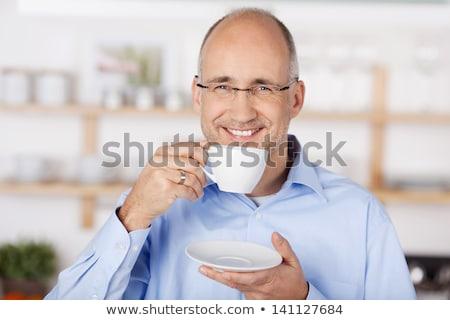 bald man drinking coffee stock photo © sarymsakov