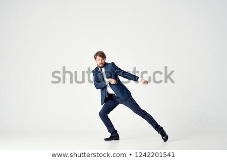 Handsome businessman pulling with hands Stock photo © wavebreak_media