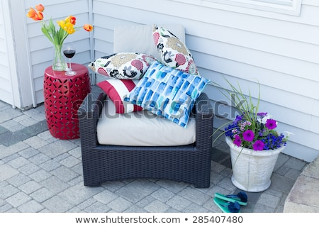 Stock fotó: Pile Of Colorful Cushions On An Outdoor Armchair