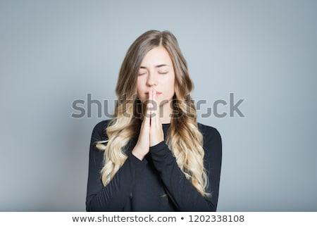 Bastante mujer rubia rezando blanco mujer manos Foto stock © wavebreak_media