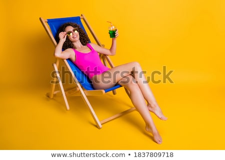 portrait of a young girl lying on deckchair stock photo © deandrobot