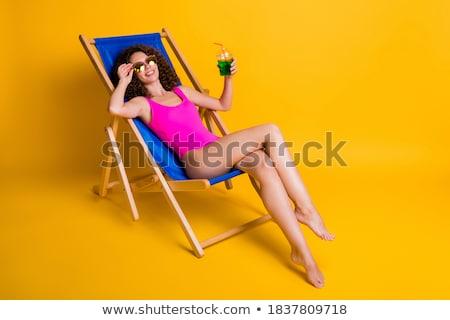 Portret jong meisje ligstoel smartphone cocktail buitenshuis Stockfoto © deandrobot