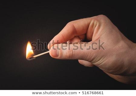 Hand holding burning match stick Stock photo © ozaiachin