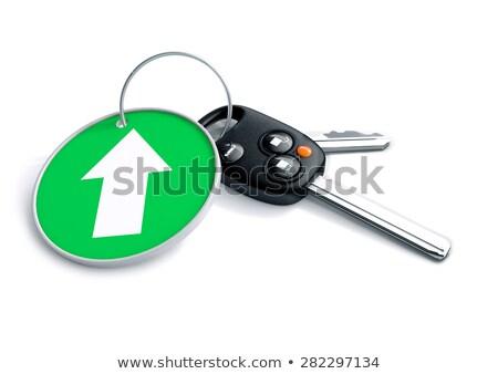 set of car keys and keyring isolated on white with arrow on gree stock photo © crashtackle