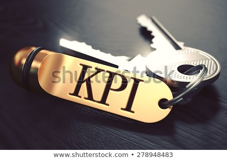 indexing   bunch of keys with text on golden keychain stock photo © tashatuvango