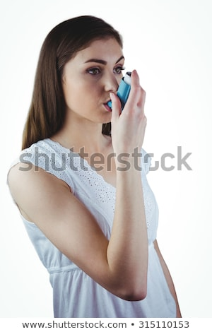 Pretty woman using her inhaler  Stock photo © wavebreak_media