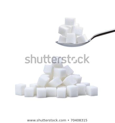 Pile of white sugar cubes Stock photo © Cipariss