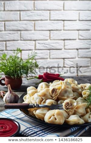 Russian hot pelmeni in a dish, close up Stock photo © fanfo