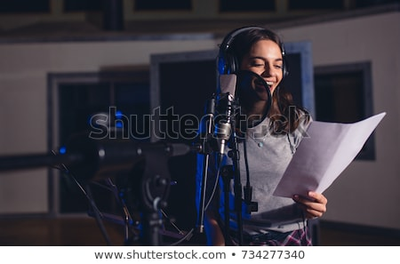 woman singer recording a new song stock photo © milanmarkovic78