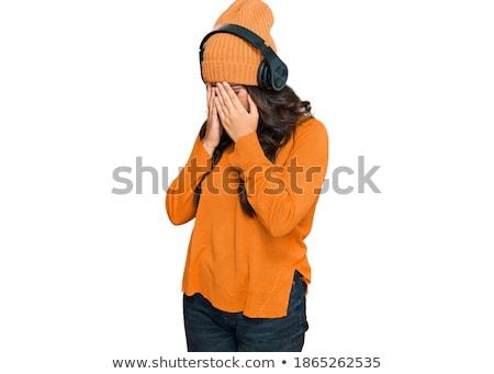 Shy giovani bruna ascoltare musica cuffie sorpreso Foto d'archivio © lithian
