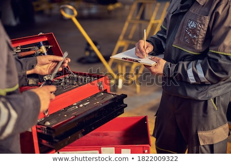 Repair man hands fixing engine on a plane Stock photo © deandrobot