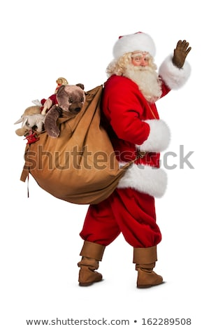 Santa Claus and red bag. Big sack with gifts. Giving gifts at Ch Stock photo © MaryValery