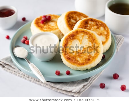 Blue cup with red berries on a plate stock photo © Karpenkovdenis