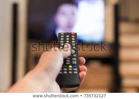 Man using remote control to change channels Stock photo © wavebreak_media
