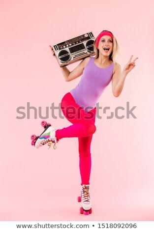 Kadın paten poz gülen tshirt Stok fotoğraf © dash