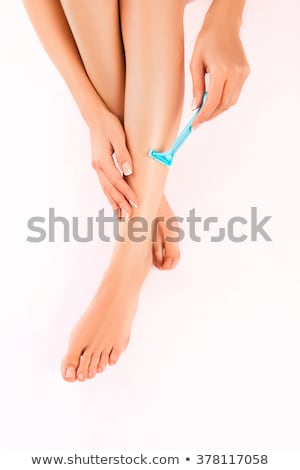woman shaves her leg stock photo © nobilior