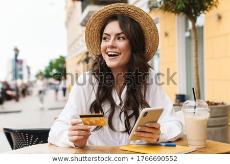Portrait of smiling young woman holding milkshake at cafe Stock photo © wavebreak_media