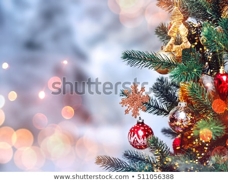 Christmas tree on a gold and red sparkly background Stock photo © alphaspirit