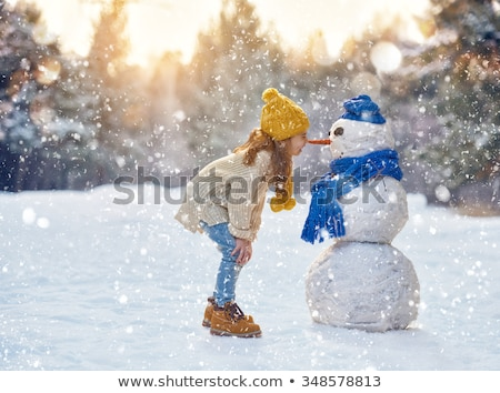 Little girl playing in snow Stock photo © IS2