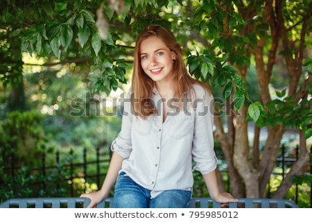 portrait of a blue eyed blonde in jeans shirt Stock photo © feedough